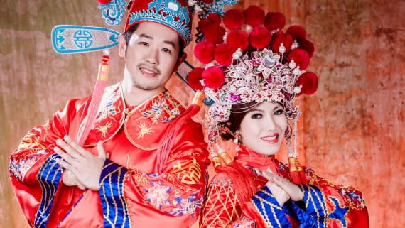 Chinese wedding with typical attire of the bride and groom