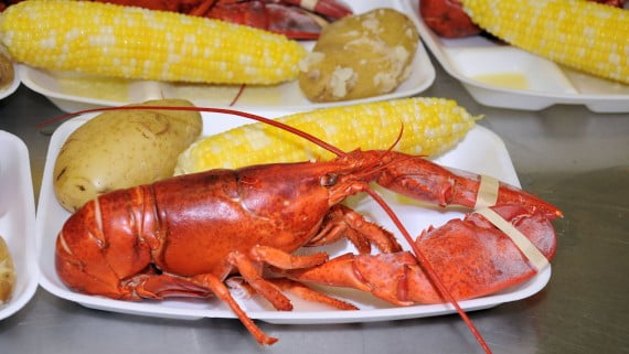 Boiled lobster with corn