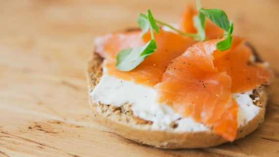 Salmon tartine with salmon and cheese on rustic bread